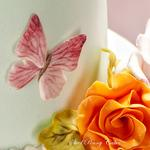 Hand painted 3D butterfly and sugar rose.