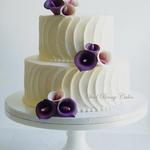Textured buttercream with plum sugar calla lilies.