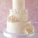 Ruffles and royal icing alencon lace with roses, peonies, and hydrangeas.